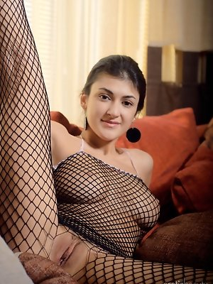 Zita B poses in her fishnet lingerie that highlights her voluptuous body